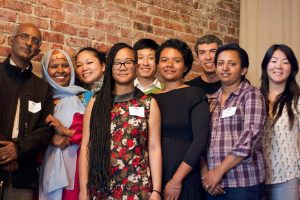 Rainier Valley Corps partners, volunteers, and advisory board members at a special awards ceremony on May 14 at The Hillman City Collaboratory. Pictured from left to right: Solomon Bisrat of Eritrean Association of Greater Seattle, Sahra Farah of Somali Community Services of Seattle, Sheila Burrus of Filipino Community Center, Ashley Sheriff of East African Community Services, James Hong of Southeast Seattle Education Coalition/Vietnamese Friendship Association (fourth from the left), Mo! Avery of Got Green?, David Sauvion of Rainier Beach Action Coalition, Ethiopia Alemneh Ethiopian Community Center and Amy Pak of Families of Color Seattle. (Photo by Elisabeth Vasquez-Hein)