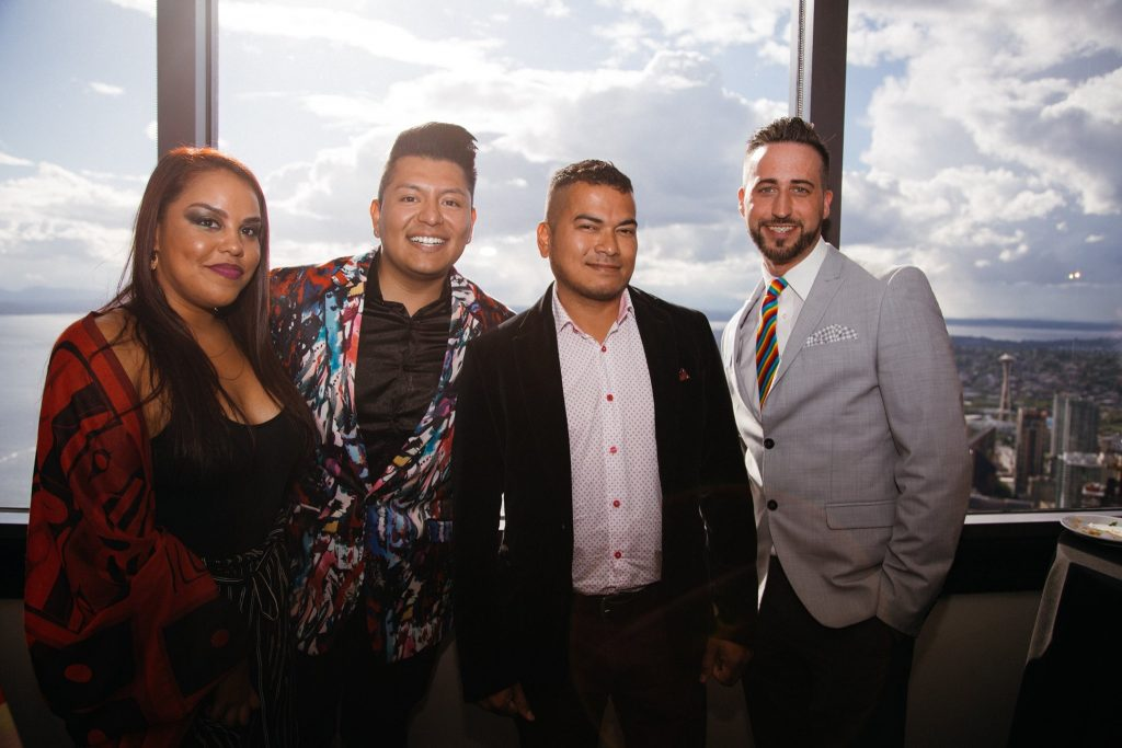 From Somos' Attendees of Somos Seattle's 50 Years of Pride Celebration, from left: Patricia Allen (Somos Contributor), Ray Corona (Somos Executive Director), Polo Barhona (Somos Board Member) and Joey Wieser (Somos Contributor). (Photo by Leo Carmona/provided by Somos Seattle)