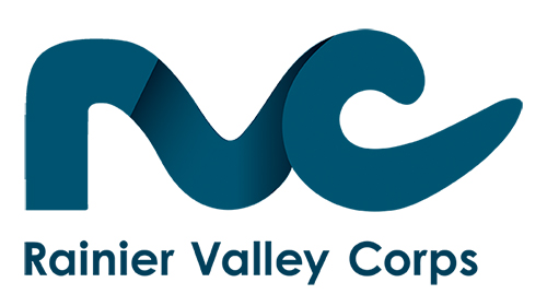 "The Rainier Valley Corps Logo, an abstract rendering of the letters R, V, and C in teal with the organization name ""Rainier Valley Corps"" underneath the logomark."